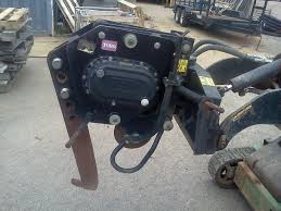 Vibratory plow attachment for Toro Dingo